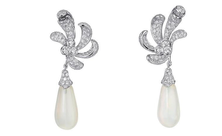 Sortilège de Cartier collection earrings in platinum with diamonds and opals.