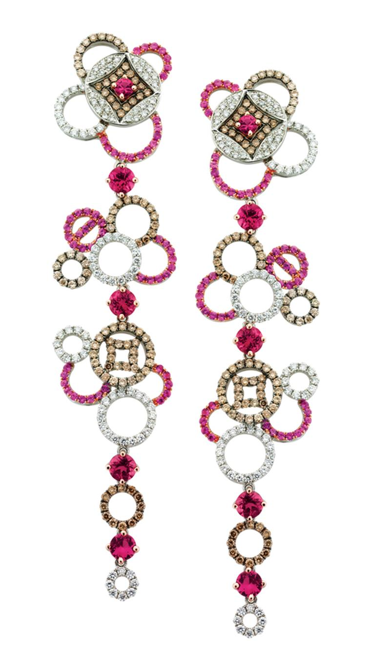 SHO Fine Jewellery Coin Drop SHO Fine Jewellery Coin Drop Earrings in 18ct White Gold with Pink Sapphires Tourmaline and White and Cognac Diamonds. £9840 in 18ct White Gold with Pink Sapphires Tourmaline and White and Cognac Diamonds. POA