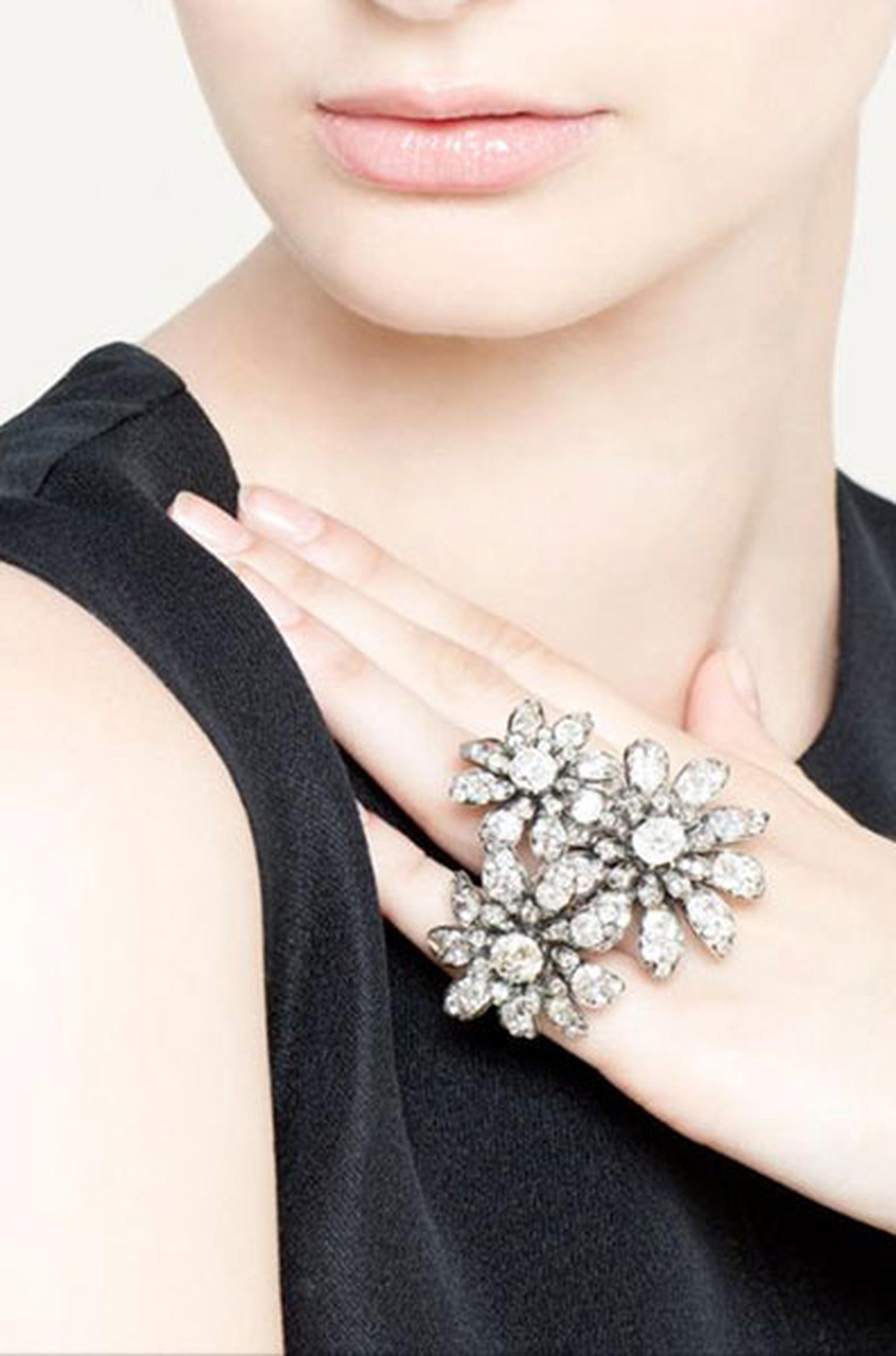 Three diamond set daisies, graduated in size, were made in 1880 and re-worked by Eliane Fattal to be worn individually or in a group in various ways:  as a finger ring on a triple diamond hoop twisted like a stem, as pins in the hair or as brooches.