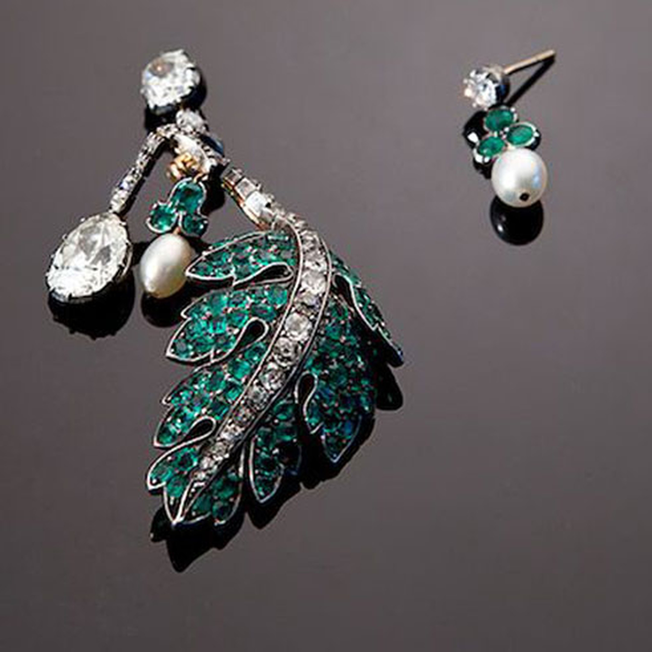 Eliane Fattal for S.J. Phillips. Oak Leaf and Acorn  jewel, c.1860 The diamond and emerald oak leaf branch with a pear shaped diamond pendant and emerald capped pearl acorn. They can be worn as a hand ornament or divided into a pair of asymmetri...