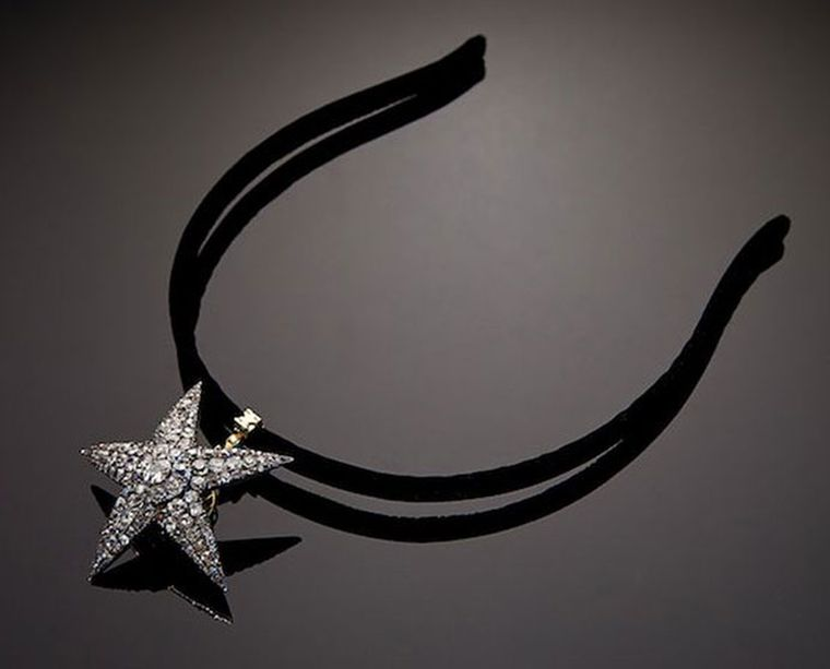 S.J. Phillips and Eliane Fattal. The Star detached can be worn in the hair.