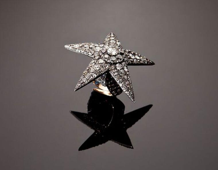 The Star as a ring. The diamond-set star screws off and the ring can be worn on its own while the star sits in the hair or dangles from a chain as a pendant.