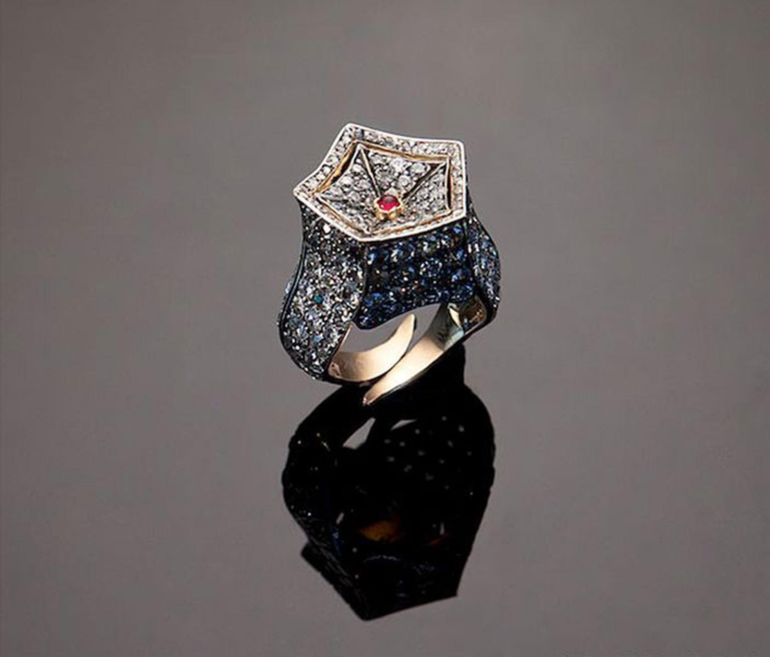 The Star by Eliane Fattal and S.J. Phillips. Once the star is removed in its place a ruby can be mounted in the concave pavé set diamond bezel.