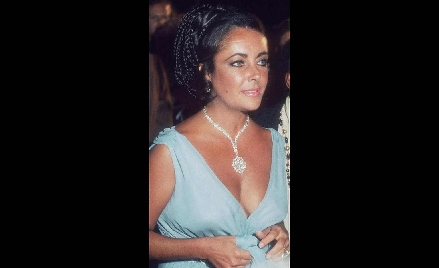 "At the 1974 premiere of ""That's Entertainment"" wearing the Van Cleef & Arpels brooch as a necklace, given to her by Richard Burton and one of the most valuable pieces with a $1,500,000 price tag when he bought it in 1969."