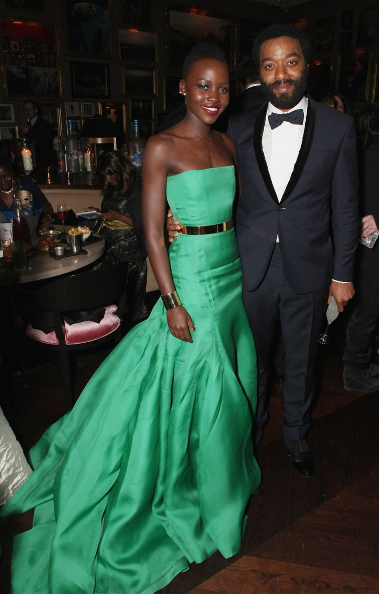Lupita Nyong'o, BAFTA nominee for her role in '12 Years a Slave', wore an emerald green Dior dress accessorised with two Ana Khouri gold cuff bracelets
