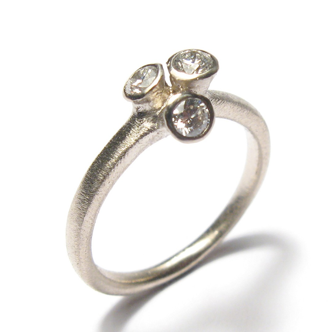 Diana Porter 18ct Fairtrade white gold ring with three 0.10ct diamonds (from £1,163)