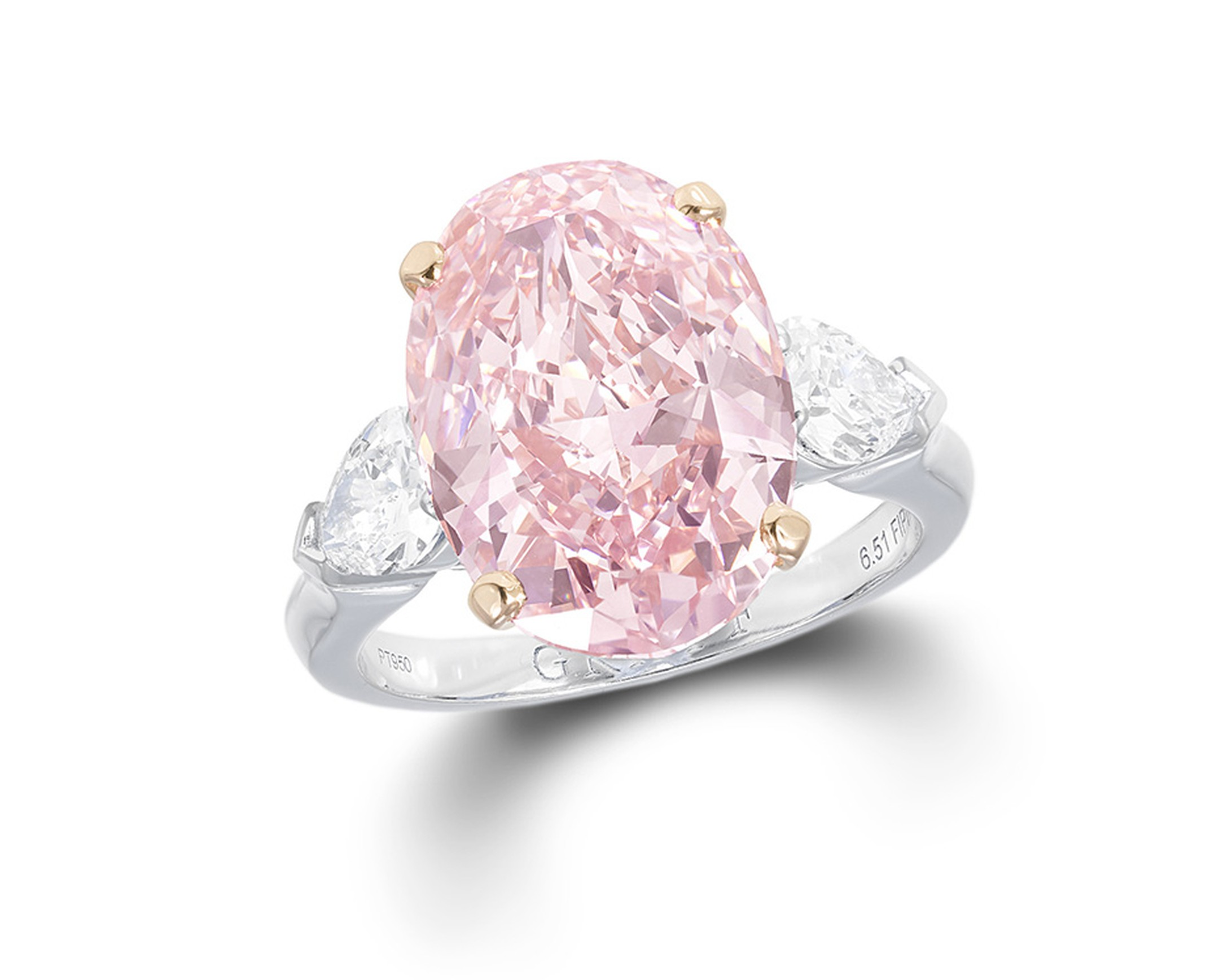 Graff Diamonds solitaire diamond ring, set with a 6.51ct oval cut Fancy Intense pink diamond
