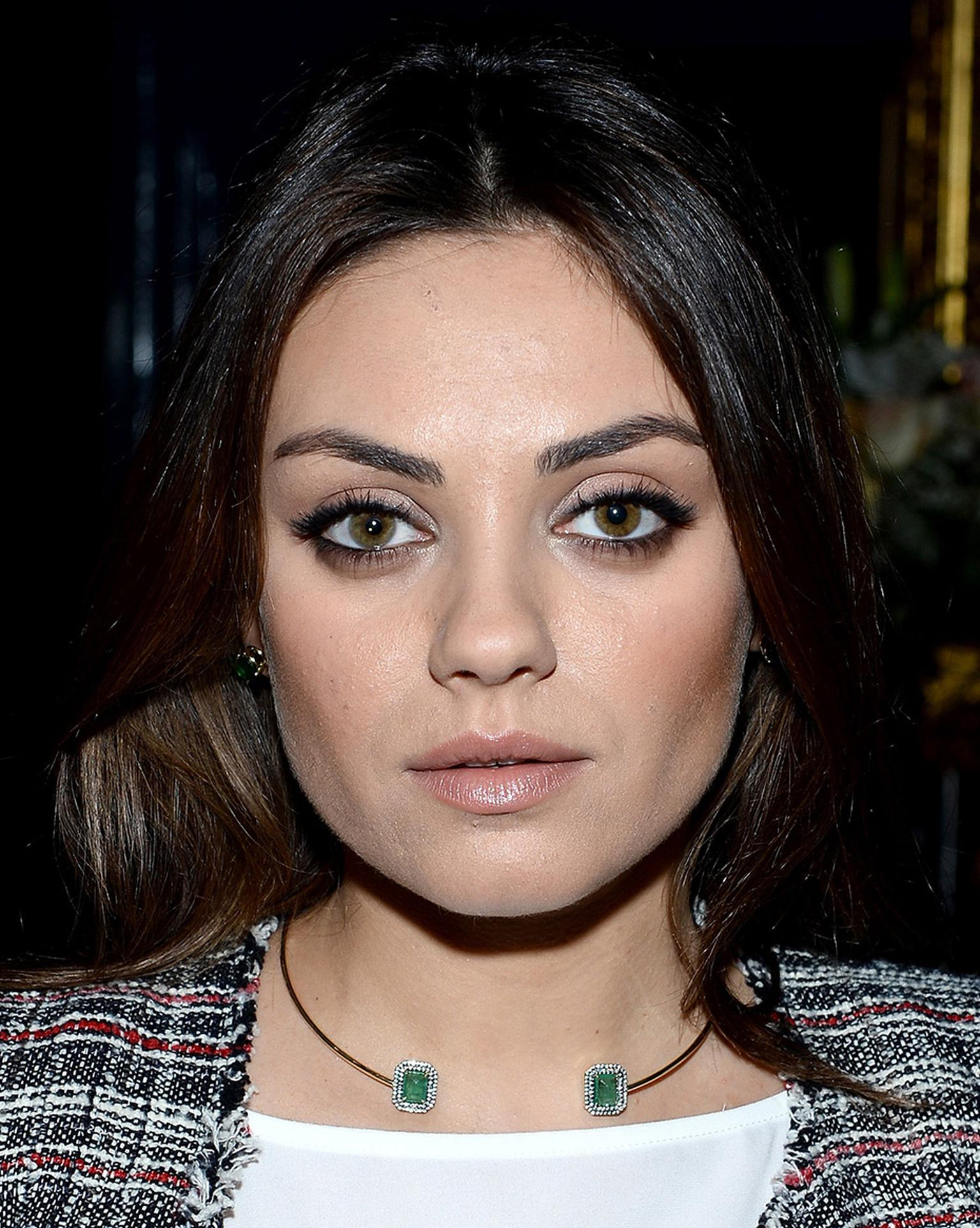 Mila Kunis wearing the Jemma Wynne emerald collar in yellow gold, created in collaboration with Gemfields