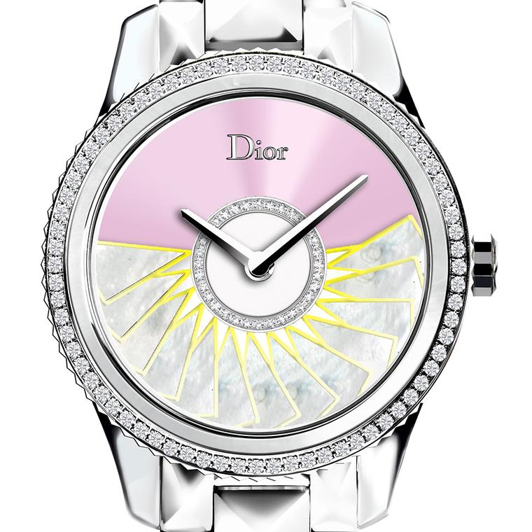 The new Dior VIII Grand Bal Plissé Soleil watch features a galvanised steel dial tinted with a slash of bold pink
