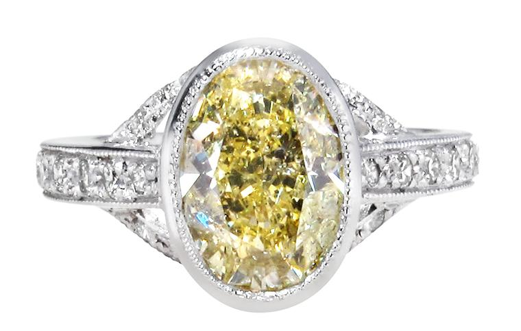 Ingle & Rhode bespoke VIntage engagement ring, set with an oval-cut 1.4ct fancy yellow diamond (POA)
