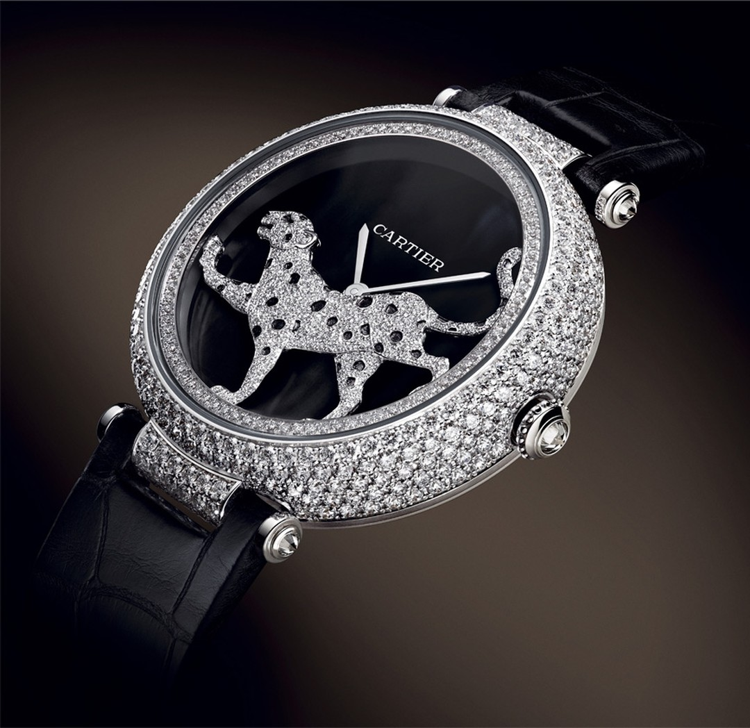 Cartier. Masse Secre`te panther de´cor watch, Calibre 9603. White gold, diamonds, deep purple mother of pearl and sapphire. Black semi-matte alligator skin. POA. 2