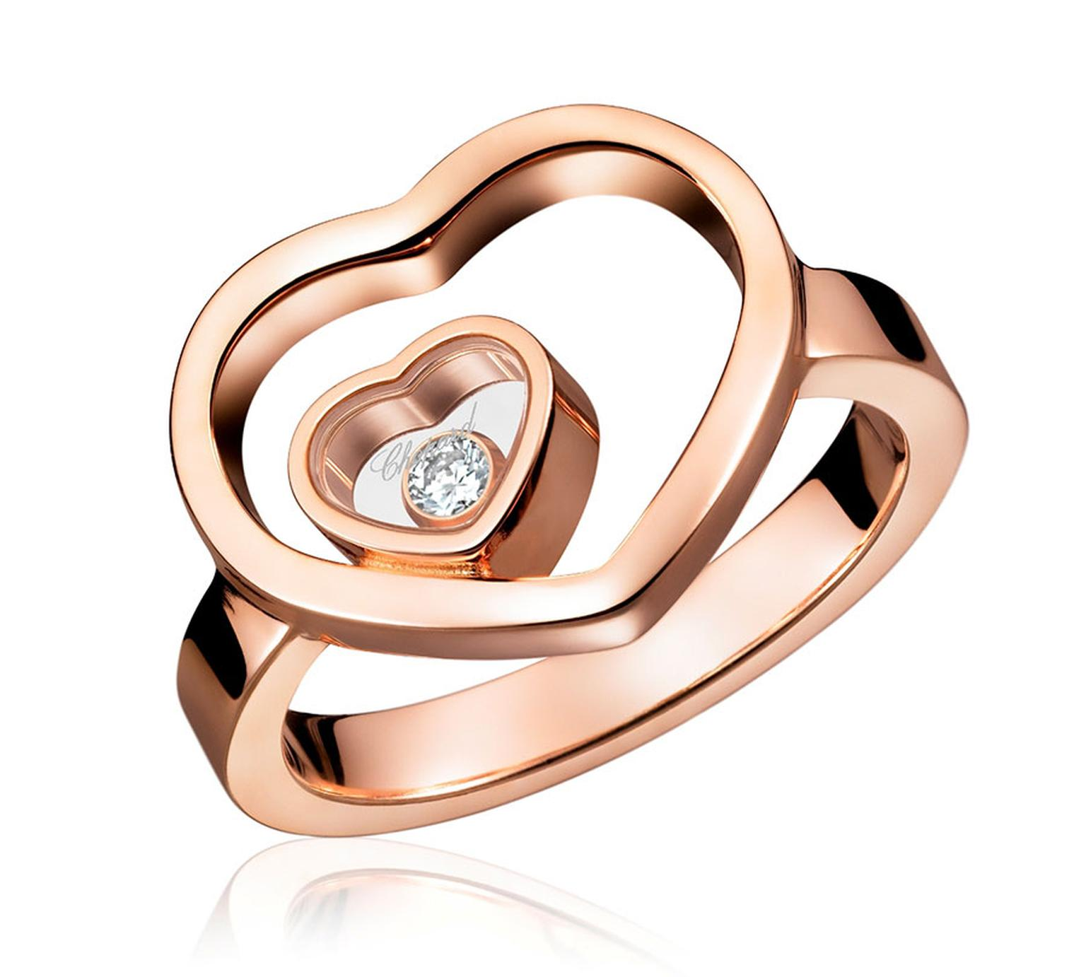 "Chopard Heart Ring from the ""Miss Happy"" collection in rose gold 18ct set with diamonds and with one Happy Diamond – Price £ 2,740"
