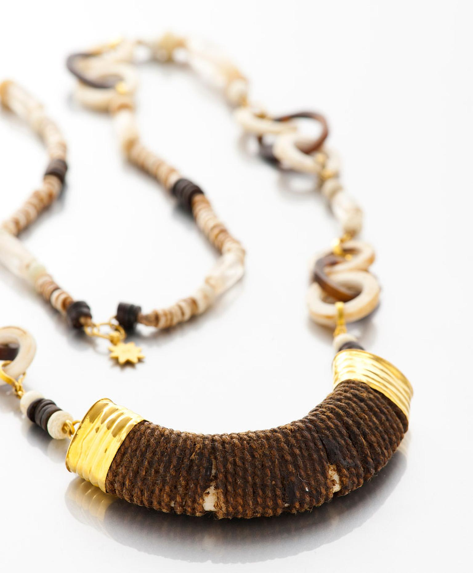Lisa-Black-Boars-Tusk-Pendant-on-Necklace-of-Shell-and-Tortoise.jpg