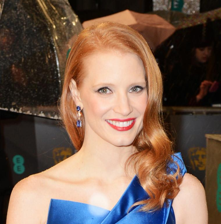 Jessica Chastain arriving at the 2013 BAFTAs in Harry Winston sapphire and diamond earrings, set in platinum