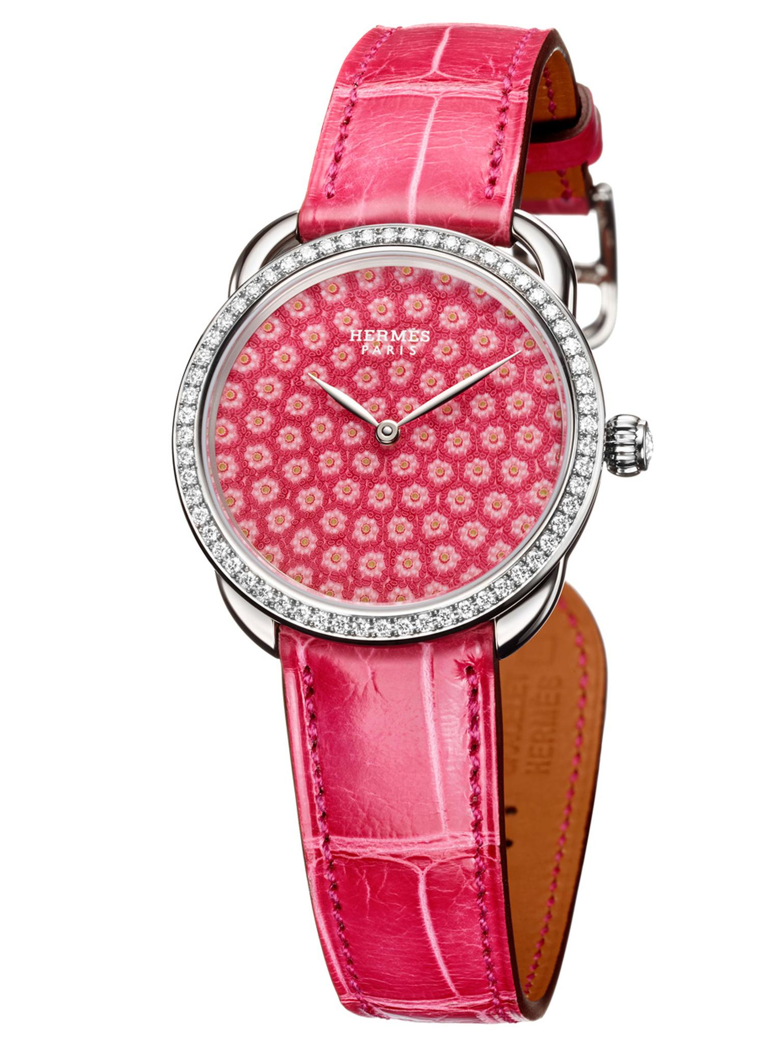 Hermès' Arceau Millefiori watch is decorated with thousands of miniature pink glass flowers crafted by Les Cristalleries de Saint-Louis in France, the same company that has been blowing life into glass paperweights since 1586.
