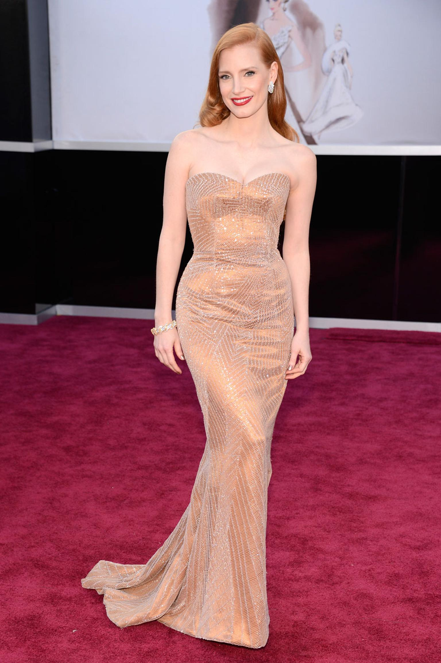 Best Actress nominee at the Oscars 2013, Jessica Chastain, in vintage 1960s Harry Winston diamond earrings and diamond and gold bracelet