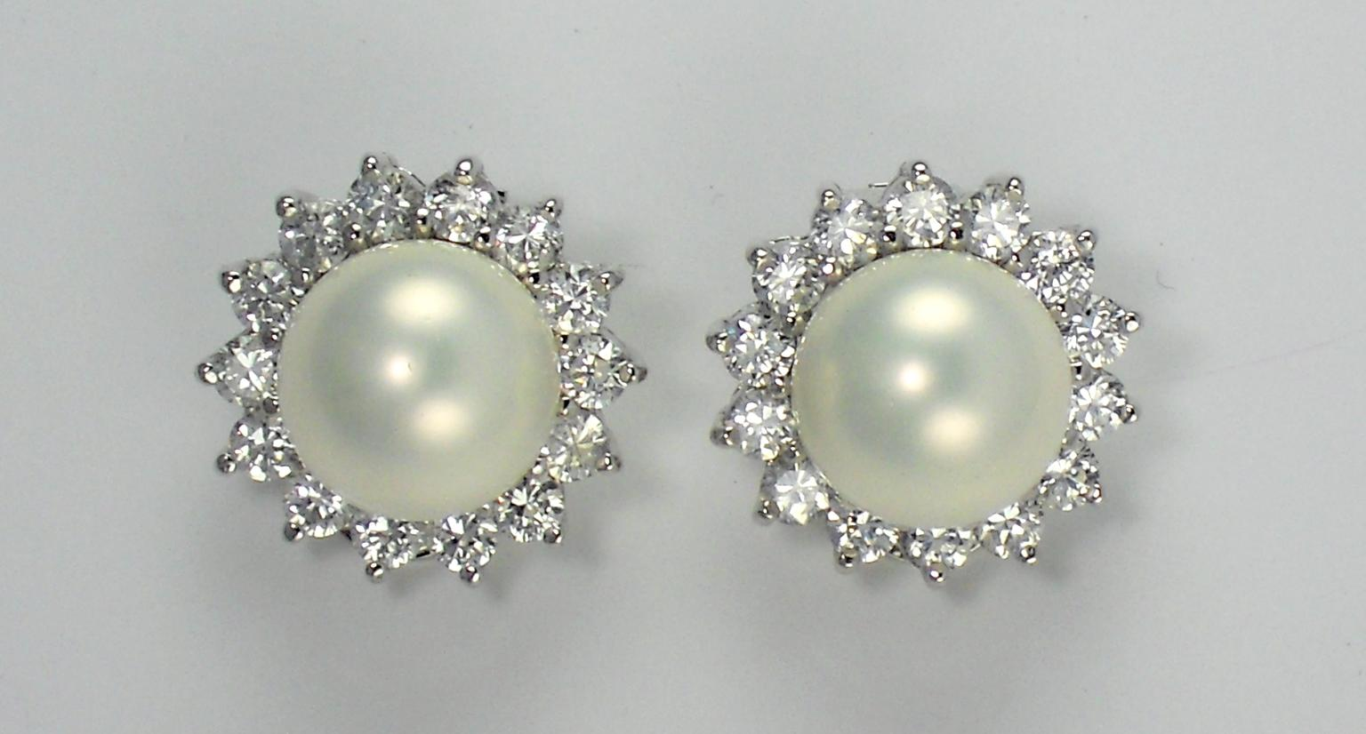 CIRO. Sterling silver rhodium plated shell pearl earrings with brilliant cut cubic zirconia stones.jpg