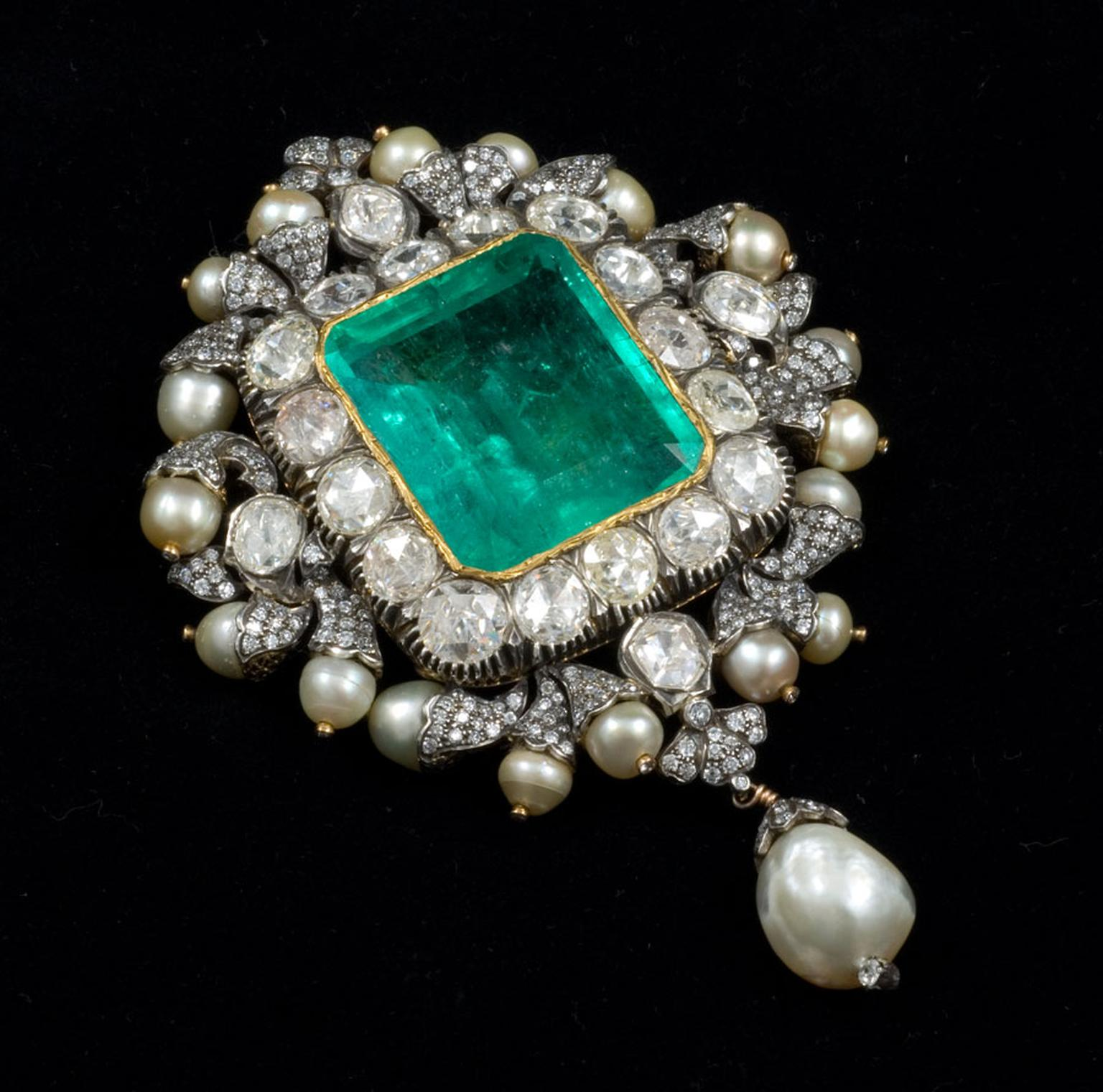 Gem Palace Sanjay Kasliwal-designed brooch with a central emerald, which doubles up as a pendant.