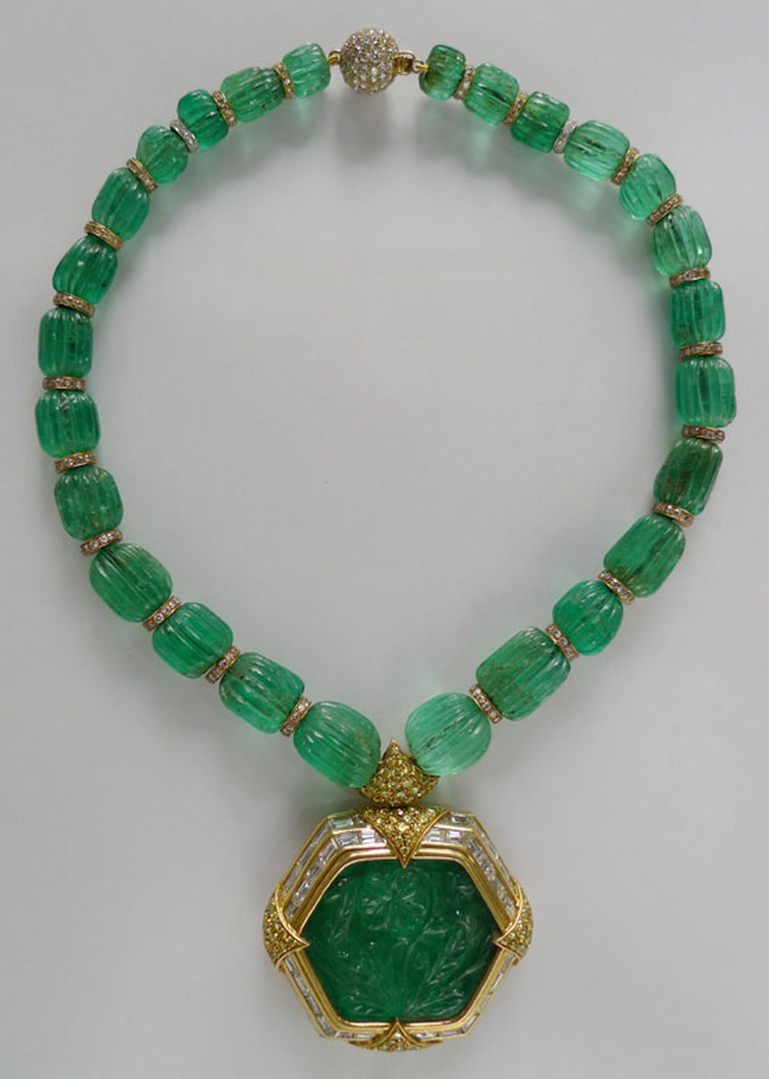 Gem Palace emerald necklace featuring a central carved emerald.