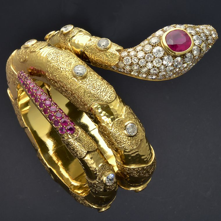 A bejewelled Codognato snake ring in yellow gold