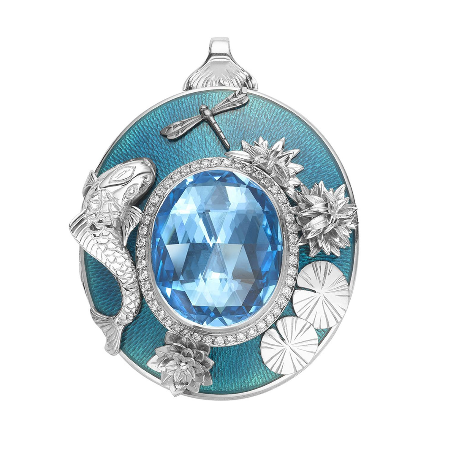This 18ct white gold and enamel Theo Fennell locket pays homage to the Koi Carp. The front showcases a sea-blue 29.13ct topaz surrounded by diamonds and sealife, while the is engraved with a Koi Carp.