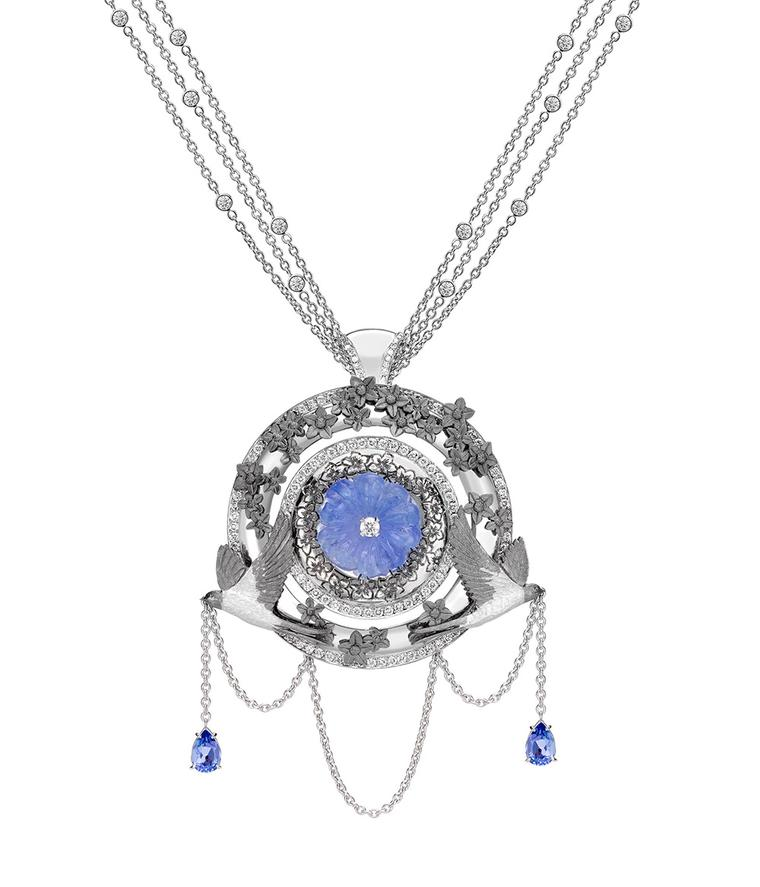 Part of Theo Fennell's Summer Suite, the Carved Tanzanite Swallow Pendant in 18ct white gold features a central 6.75ct tanzanite carved into the shape of a forget-me-knot and can also be worn as a brooch (£26,000).