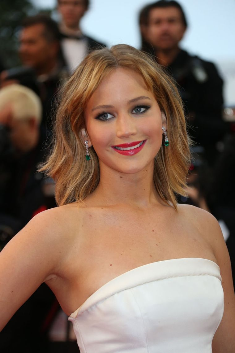 Actress Jennifer Lawrence wore a pair of octagonal-cut emerald and pear-shaped white diamond drop earrings from Chopard's Red Carpet Collection at the Cannes Film Festival 2013.