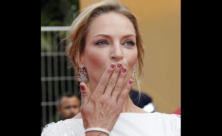 Uma Thurman, the American actress, member of the Jury, chose to wear a pair of 18ct white gold chandelier earrings set with diamonds with a matching diamond-set white gold bracelet.