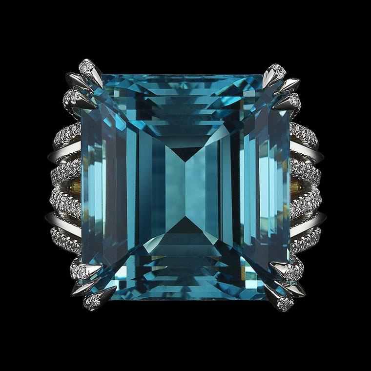 A front view of the stepped 58-facet Asscher cut aquamarine in Alexandra Mor's latest creation, which refracts light through the stone, revealing its inner depths.