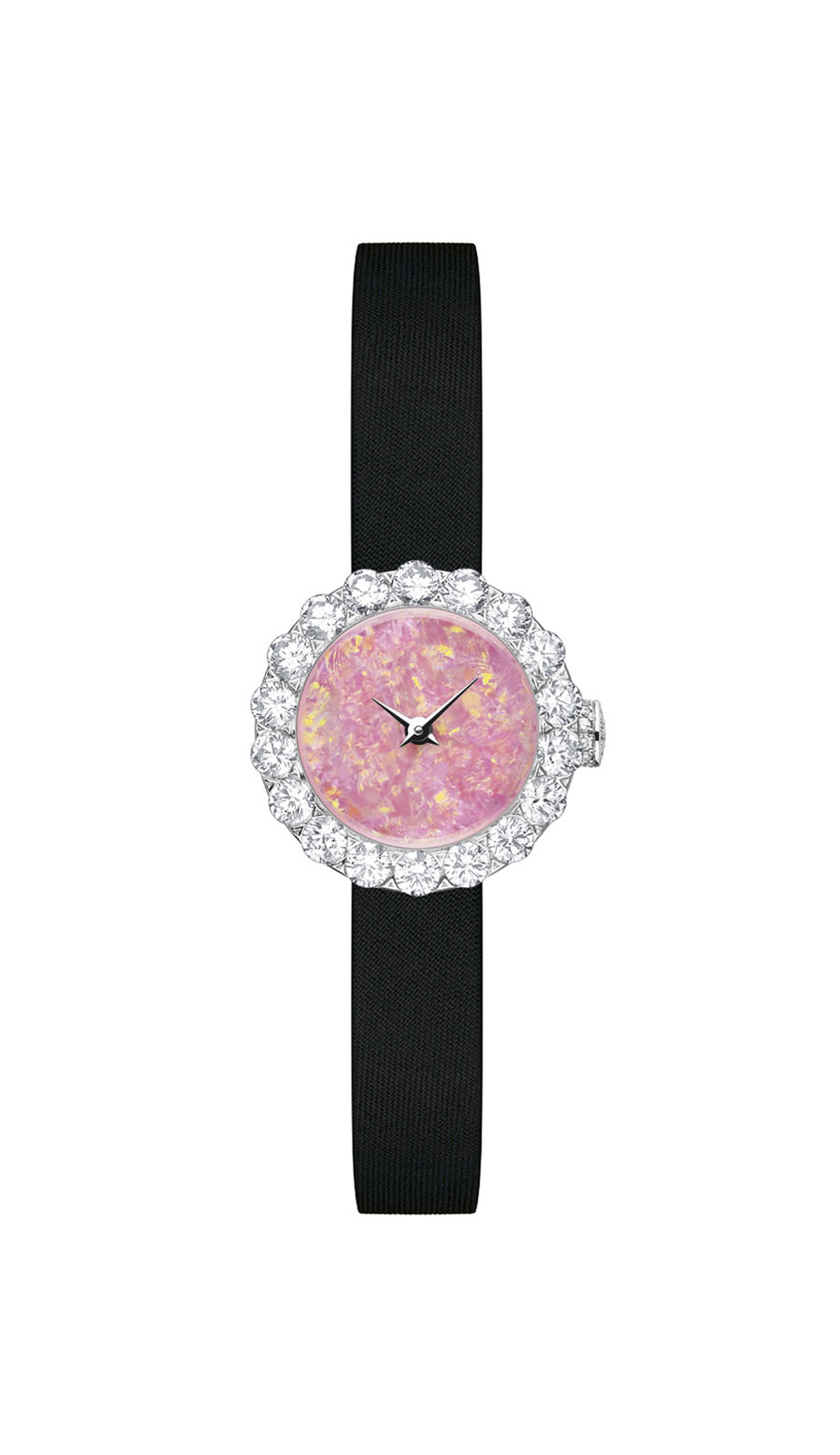 La D de Dior Preciéuse 21mm high jewellery watch in white gold with an Australian opal dial surrounded by diamonds.