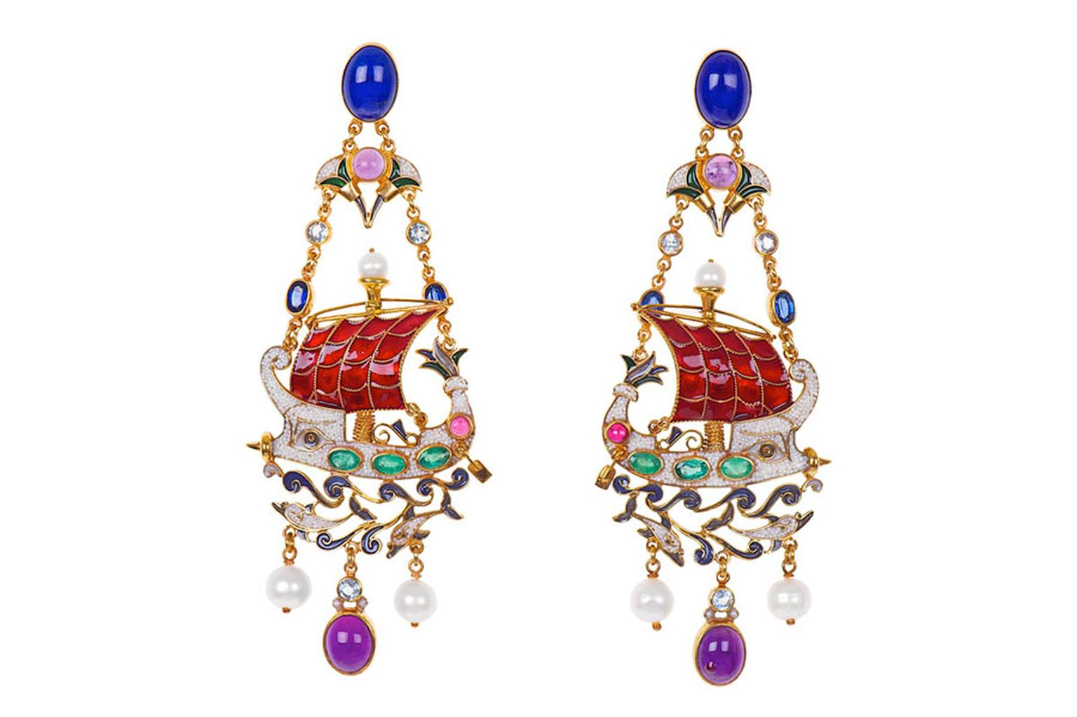 Percossi Papi earrings depicting a Phoenician ship, with a protective Isis eye and dolphins made with lapis lazuli, sapphires, emerald, ruby, amethyst and blue topaz. The hull of the ship is made from natural pearl micromosaic.