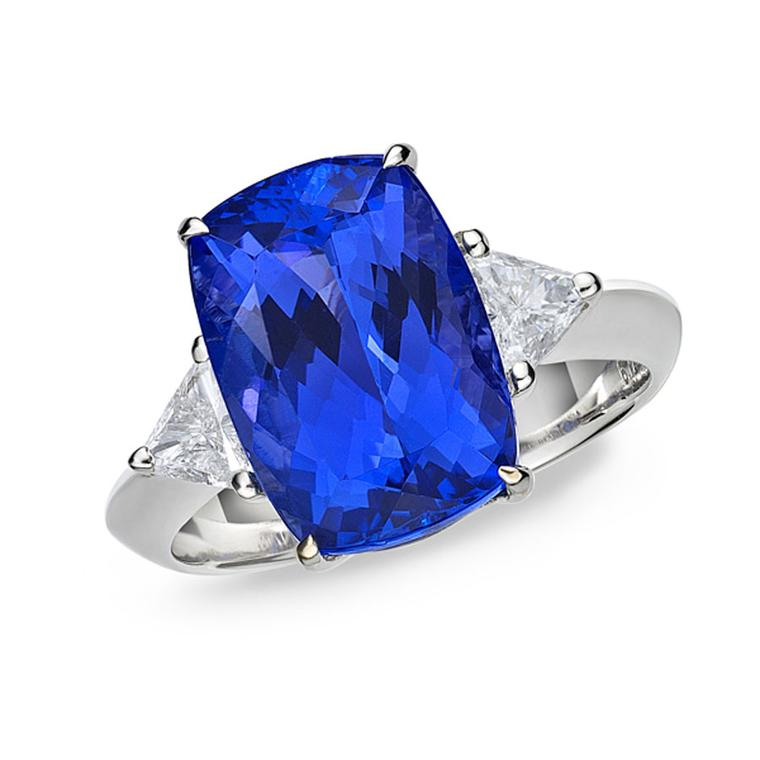 TanzaniteOne ring with a central tanzanite surrounded by two diamonds.