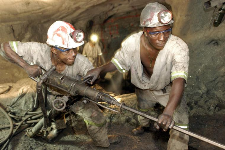 Workers at the TanzaniteOne mine drilling for tanzanite.