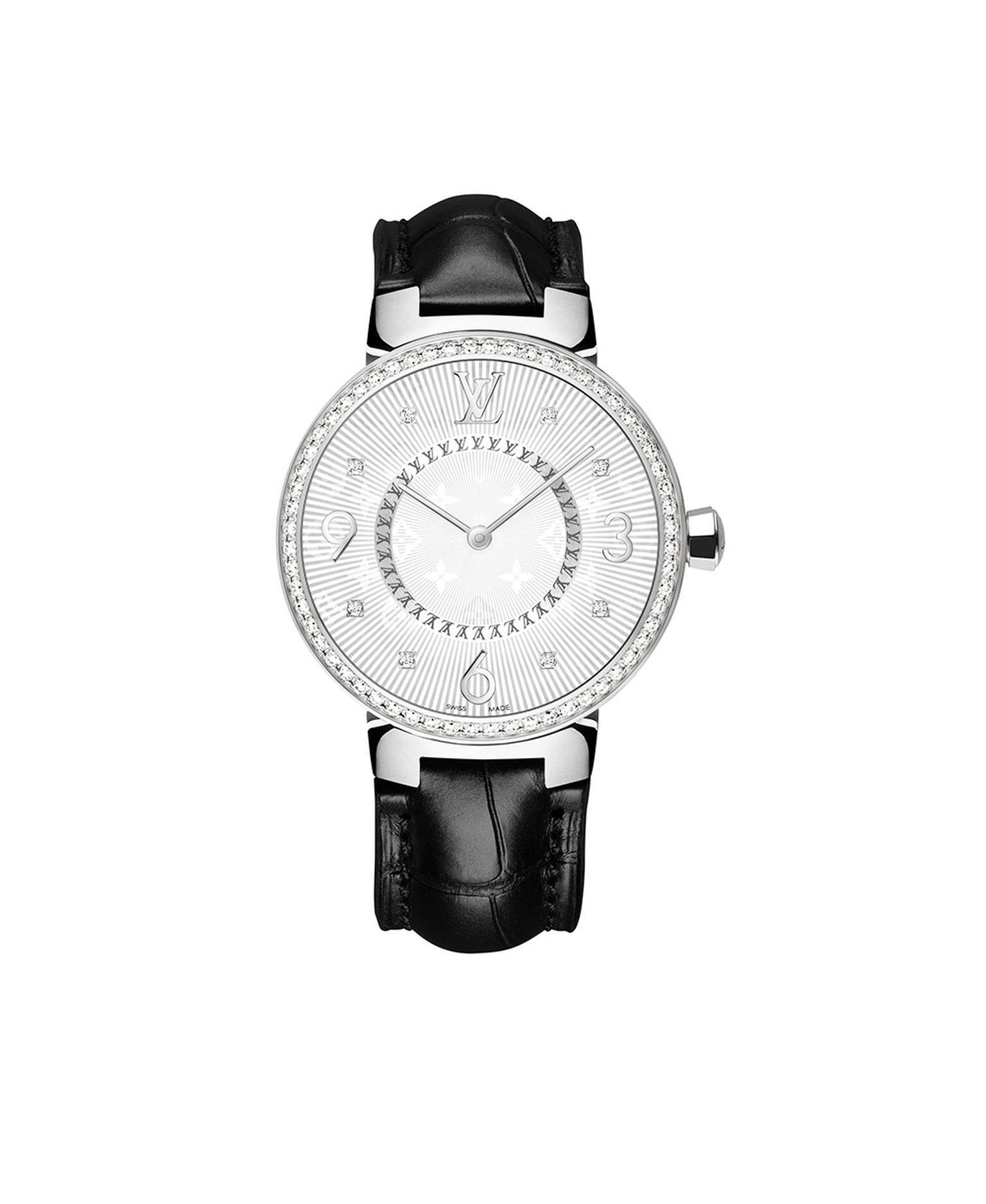 Louis Vuitton Tambour Monogram Acier Serti 28mm watch with a steel case, diamond-set bezel and quartz movement on a black alligator strap. © LOUIS VUITTON. Auteur: I REEL.