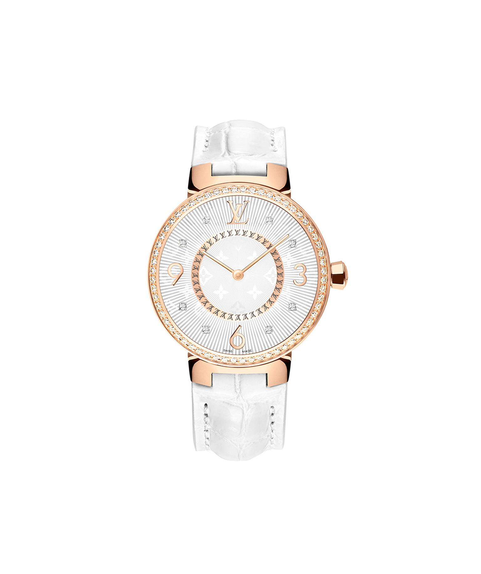 Louis Vuitton Tambour Monogram Or Rose Serti 28mm watch with a pink gold case, diamond-set bezel and a quartz movement on a white alligator strap. © LOUIS VUITTON. Auteur: I REEL.