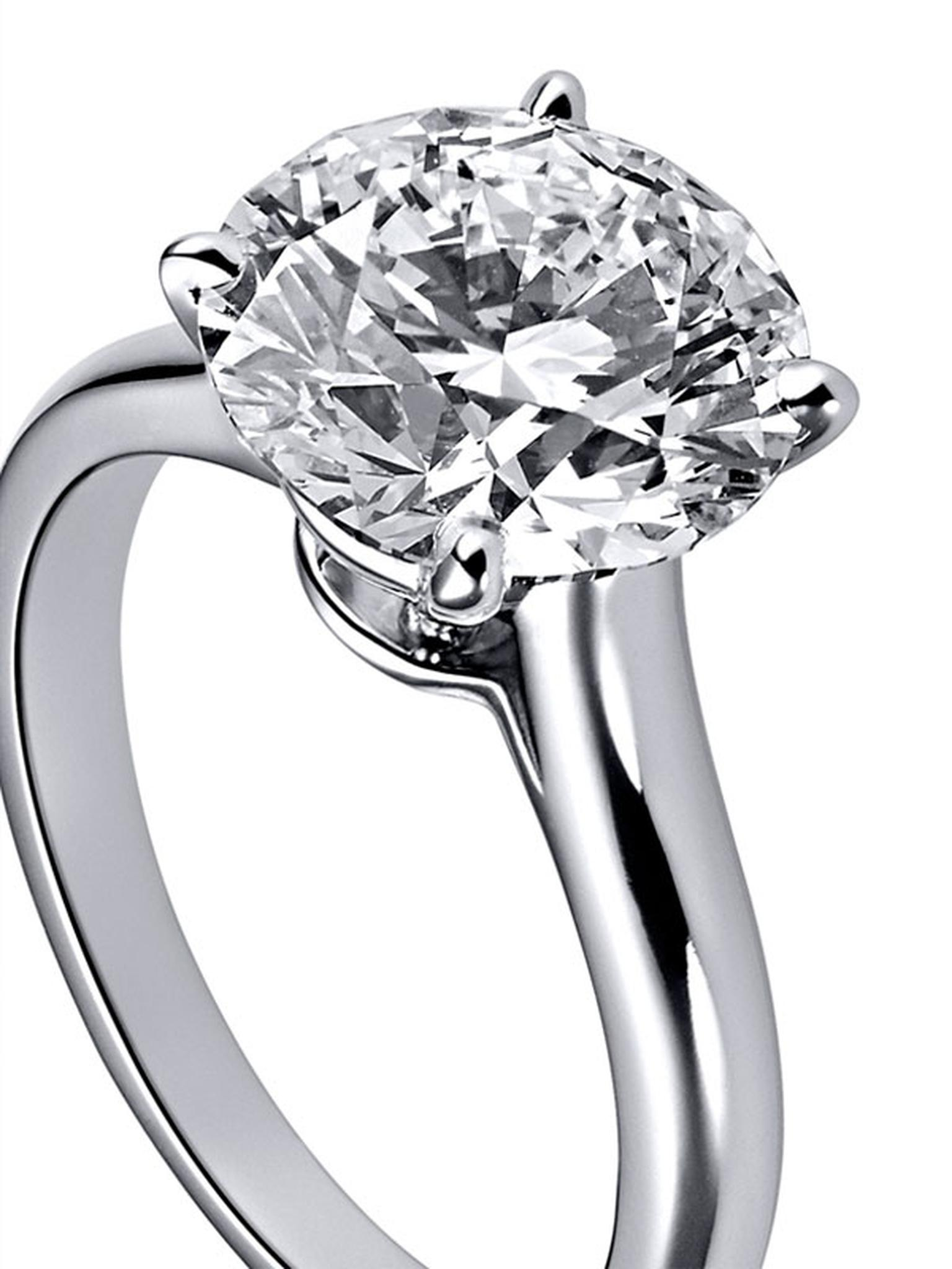Cartier-Solitaire-1895 .-Platinum,-central-brillaint-cut-diamond