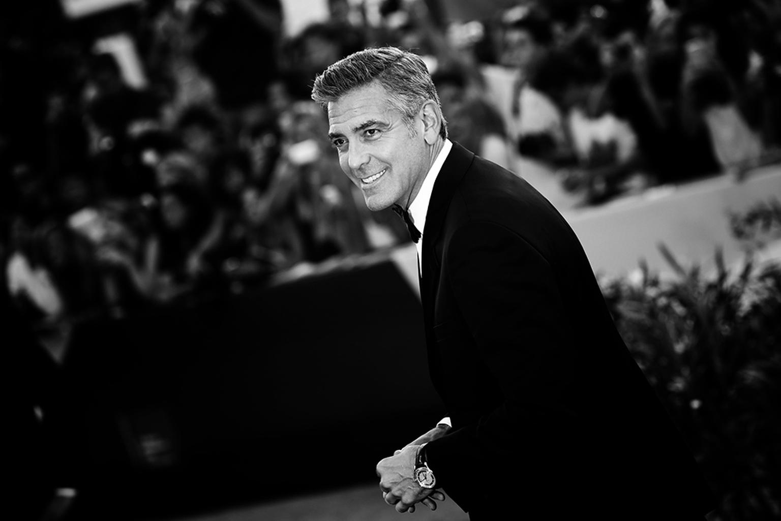 Omega ambassador George Clooney, pictured wearing an Omega De Ville Hour Vision watch at the Venice Film Festival 2013, married Amal Alamuddin this weekend in Venice wearing an Omega De Ville Trésor watch.