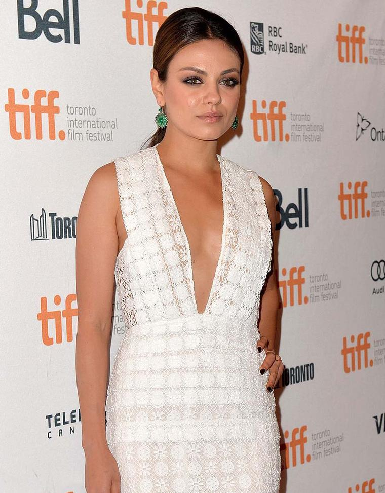 Mila Kunis steps out in Nam Cho for Gemfields earrings at the Toronto Film Festival