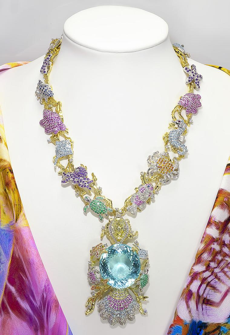 Record breaking Paraiba tourmaline is set into a one of a kind necklace before it heads to auction in 2014