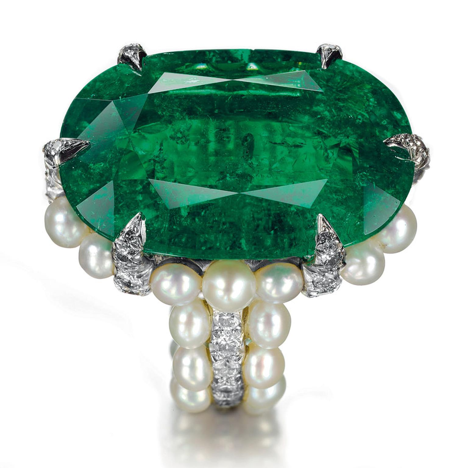 Christies Lily SafraAn-oval-shaped-Colombian-emerald,-natural-pearl-and-diamond-ring