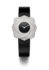 Twist the case and the petals unfurl on the new Limelight Blooming Rose watch by Piaget