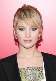 Jennifer Lawrence reveals Dior jewels beneath her newly cropped hair at Hunger Games Catching Fire premiere