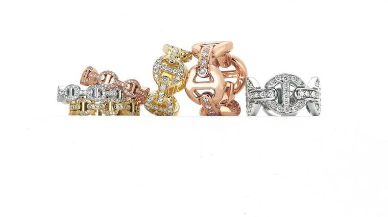 A series of Hoorsenbuhs Tri-Link rings in silver, rose gold and yellow gold with diamonds.