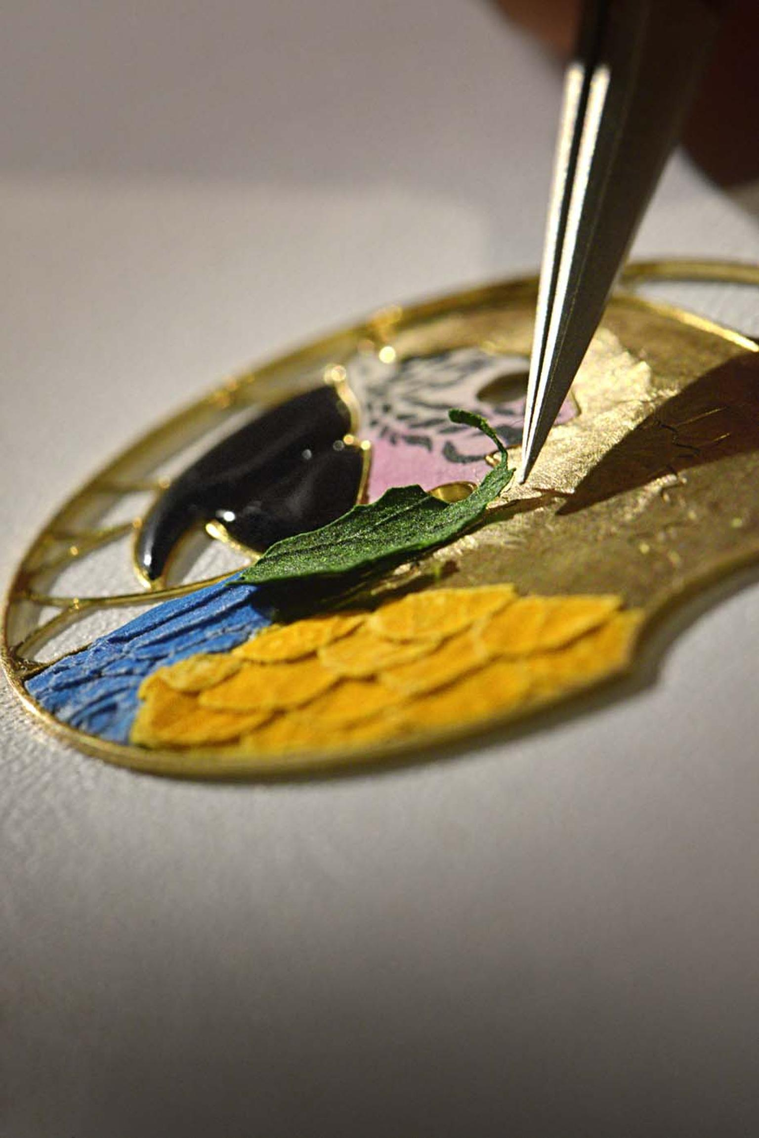 The rare handcraft of wood marquetry was used to create the dial on Cartier's Ballon Bleu de Cartier Floral-Marquetry Parrot watch