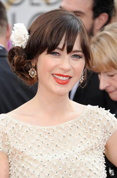 Known for her quirky vintage style, Zooey Deschanel wore estate jewels by Neil Lane to the 2014 Golden Globe Awards