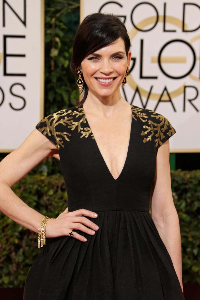 Julianne Marguilies wore 1973 estate earrings in onyx, coral and diamonds, a vintage Ludo bracelet circa 1951 and an Alhambra onyx and diamond ring, all by Van Cleef & Arpels, to the 2014 Golden Globes