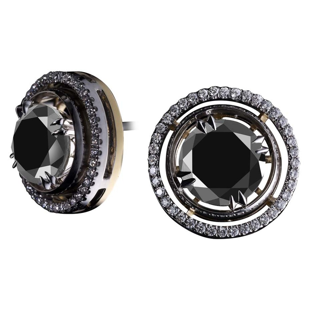 Alexandra Mor's limited edition black diamond stud earrings are available in yellow or white gold, encircled by round diamonds.