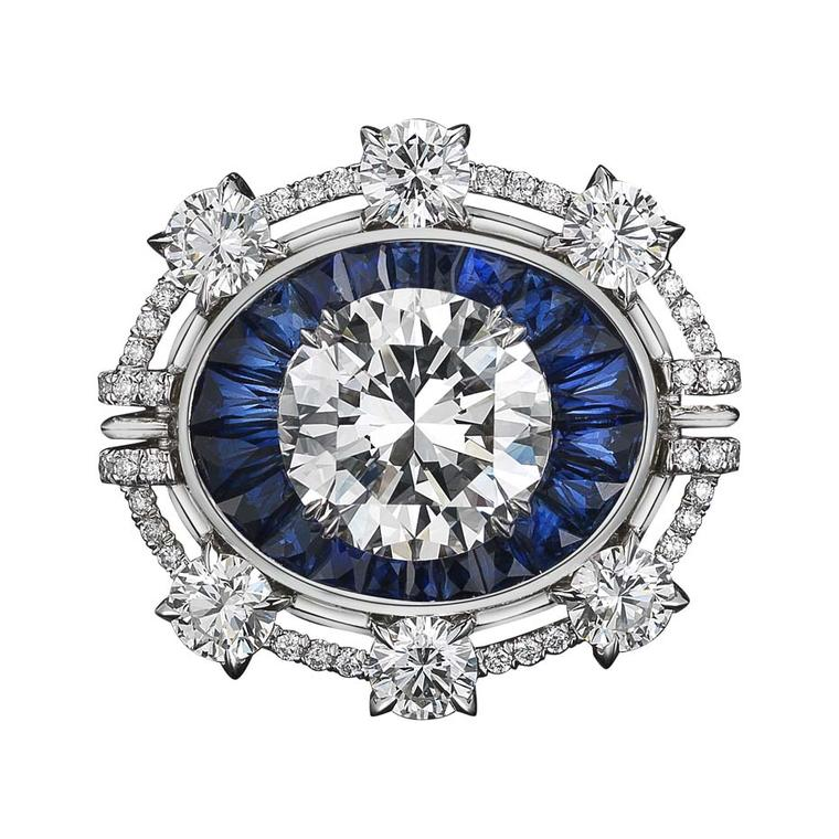 One-of-a-kind Alexandra Mor ring features 22 blue sapphire trapezoids and a 4.02ct brilliant-cut diamond, surrounded by six round diamonds set in platinum on yellow gold.