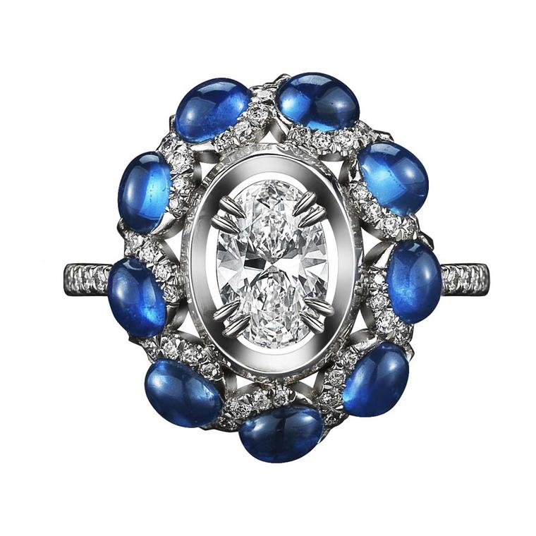 Alexandra Mor one-of-a-kind platinum ring featuring nine blue oval-cut sapphire cabochons and an oval-cut floating diamond.