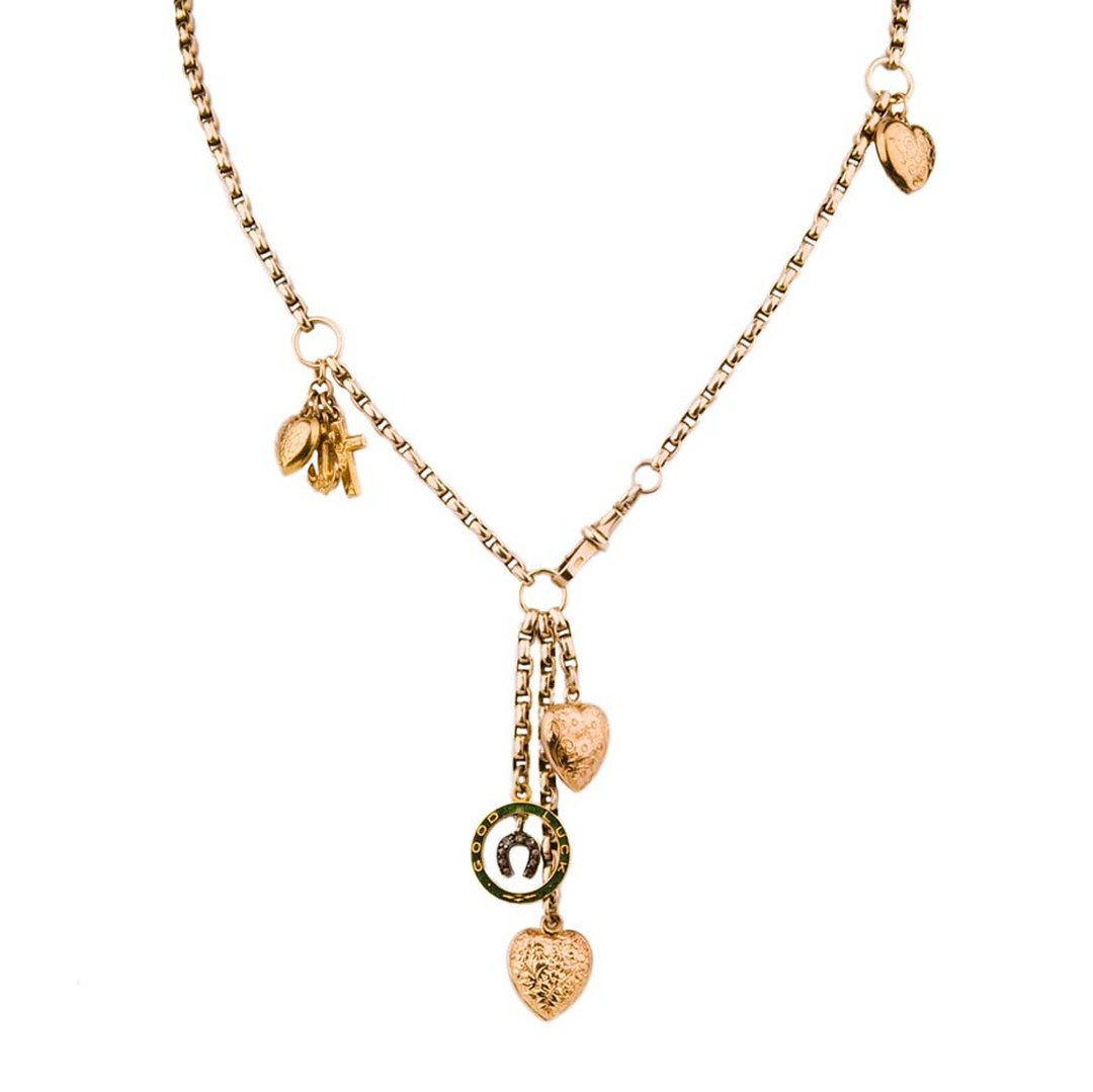 Annina Vogel's All Hearts short signature charm necklace with a goodluck horseshoe charm (£1,450).